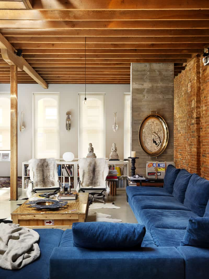 hanging living room and vancouver kitchen design. The home is a completely open floor plan  there are no walls to break off the living space kitchen or dining area save for couple of paper soft Industrial chic loft in historic Gastown district