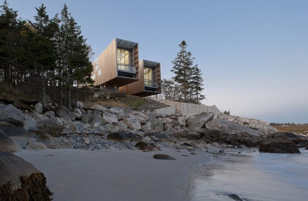 featured posts image for Two Hulls House nestled on the coastal landscape