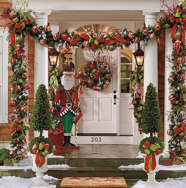 christmas porch decorating ideas 06 1 kindesign - Decorating Front Porch Urns For Christmas