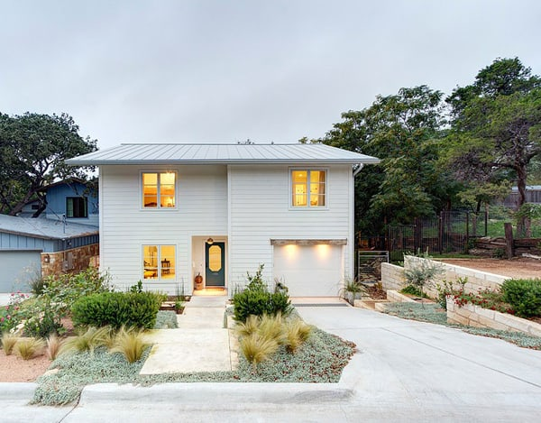 featured posts image for Bouldin Creek Residence centered around an oak tree in Texas