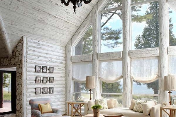 featured posts image for Charming lakefront log cabin with whitewashed interiors