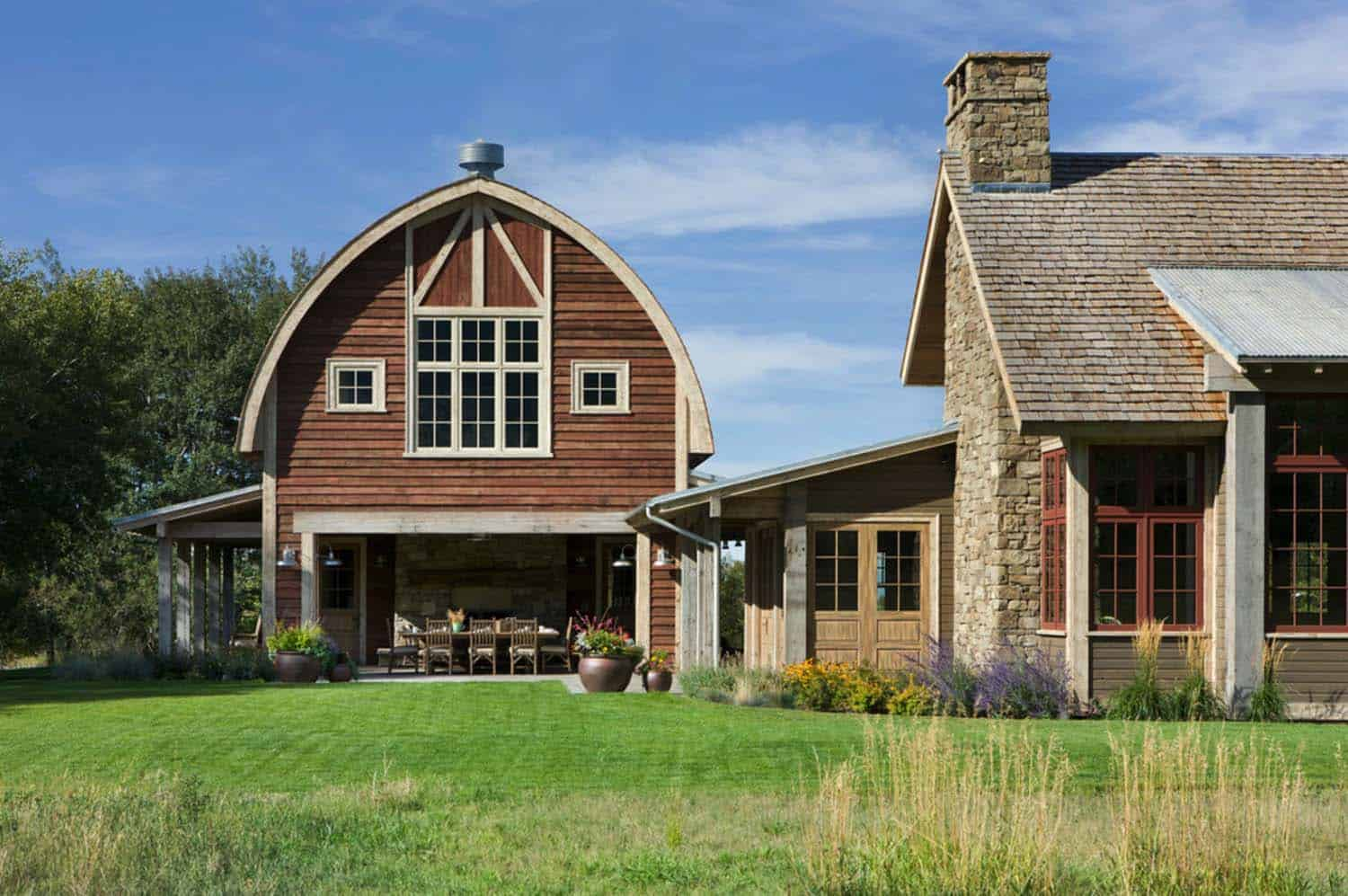 Picturesque montana farmhouse with an attached barn for Barn type homes