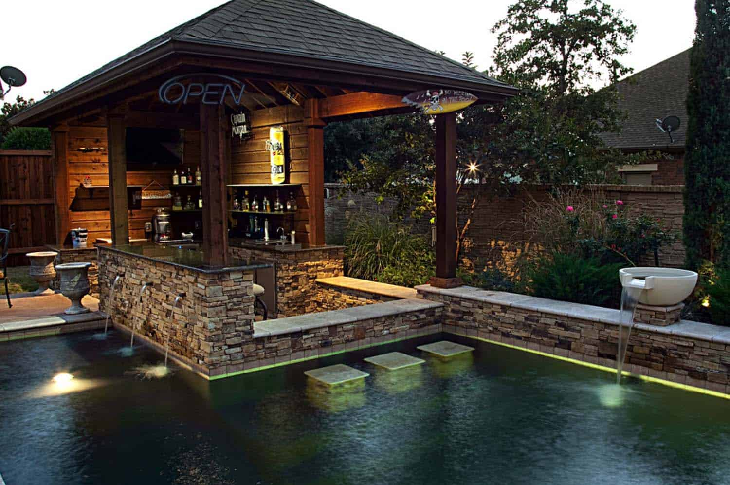 33 mega impressive swim up pool bars built for entertaining Pool house plans with bar
