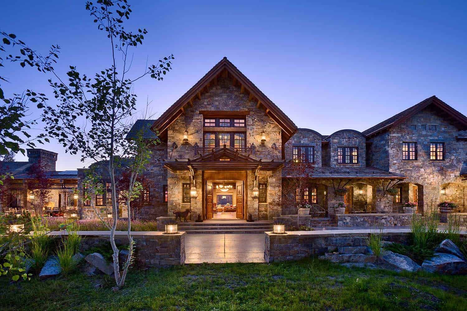 A dream home in big sky with rustic mountain style for Home plan architect