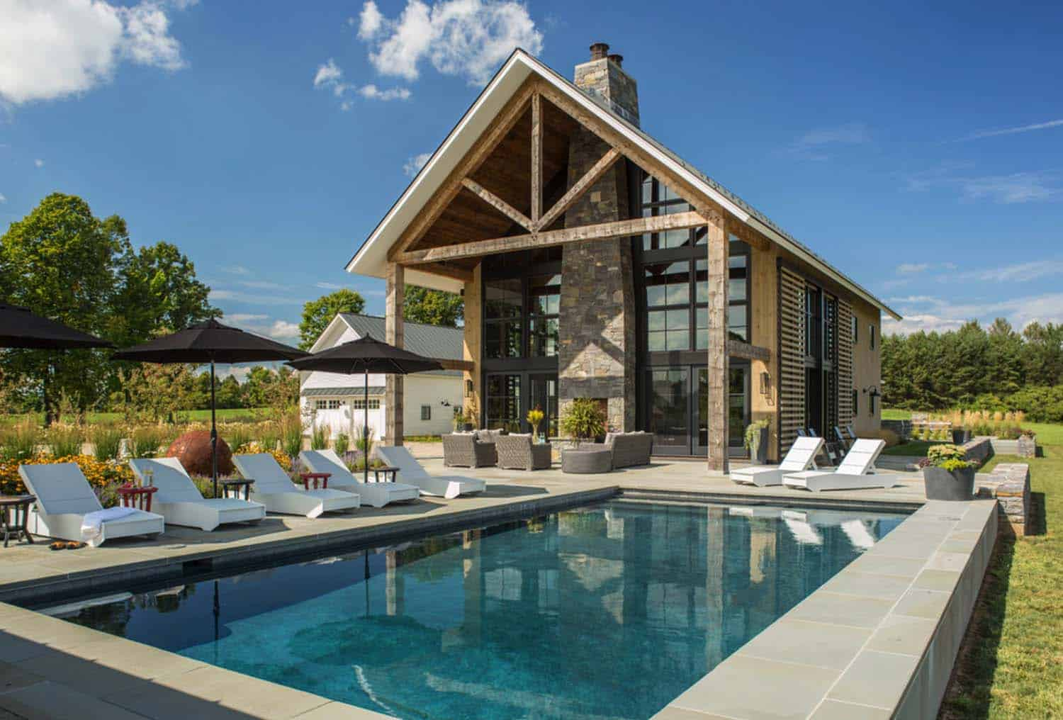 Traditional farmhouse style dwelling in Vermont with a modern twist for Small Farmhouse Design With Swimming Pool  75sfw