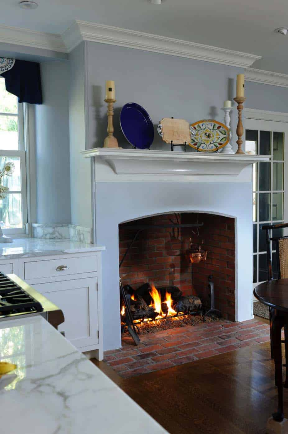 Kitchen Showcasing Cozy Fireplace-08-1 Kindesign