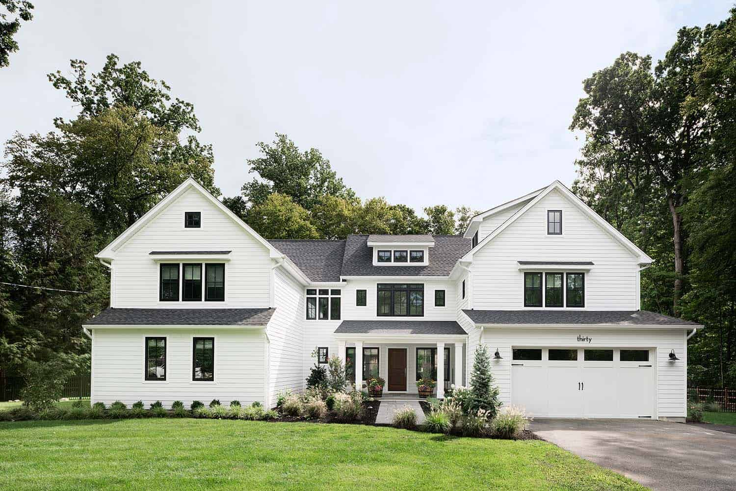 Bright and airy contemporary farmhouse style surrounded by for Modern farmhouse architecture