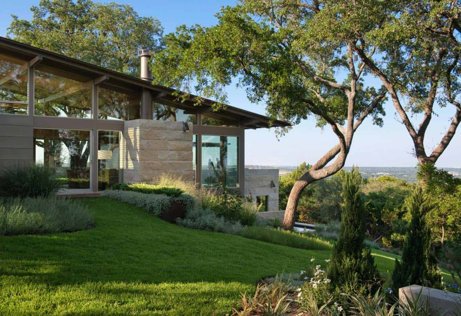 Hillside dwelling in texas with a fantastic indoor outdoor connection Home furniture rental austin texas