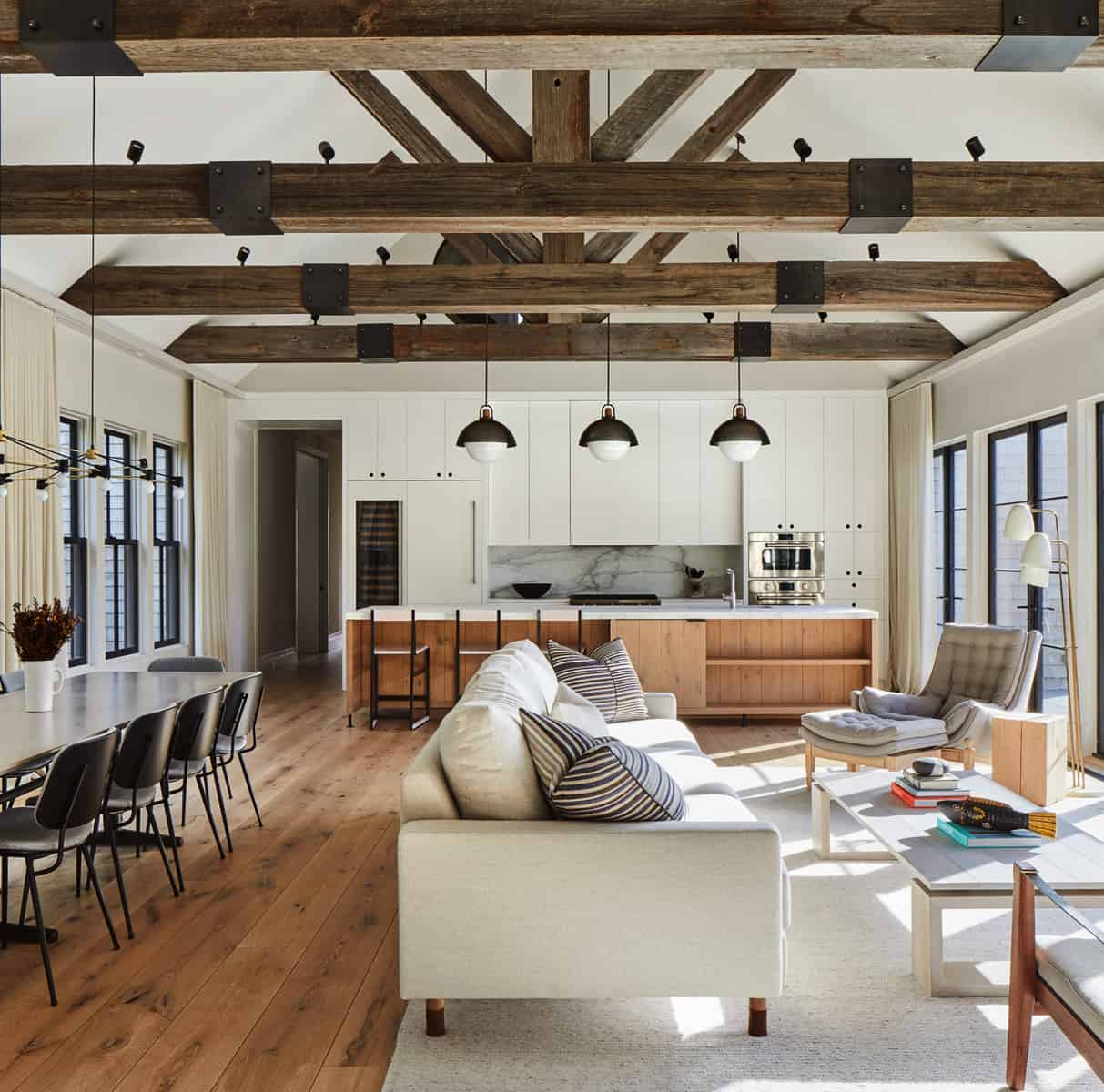 great-room-with-exposed-ceiling-trusses