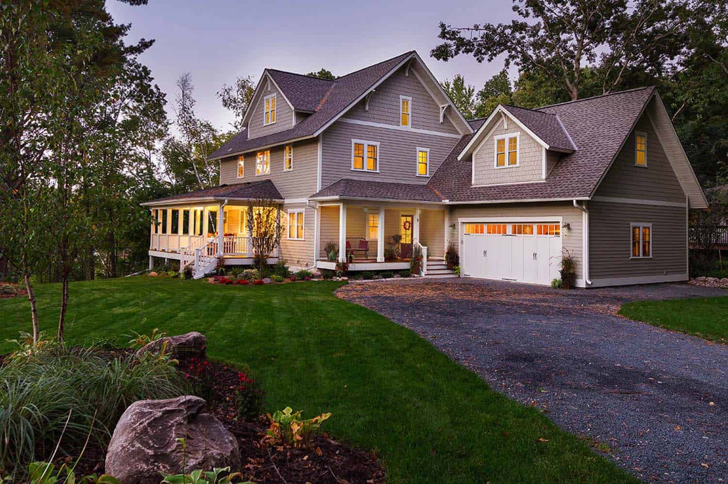 Charming lakeside farmhouse nestled on a wooded site in for Beautiful farmhouse plans