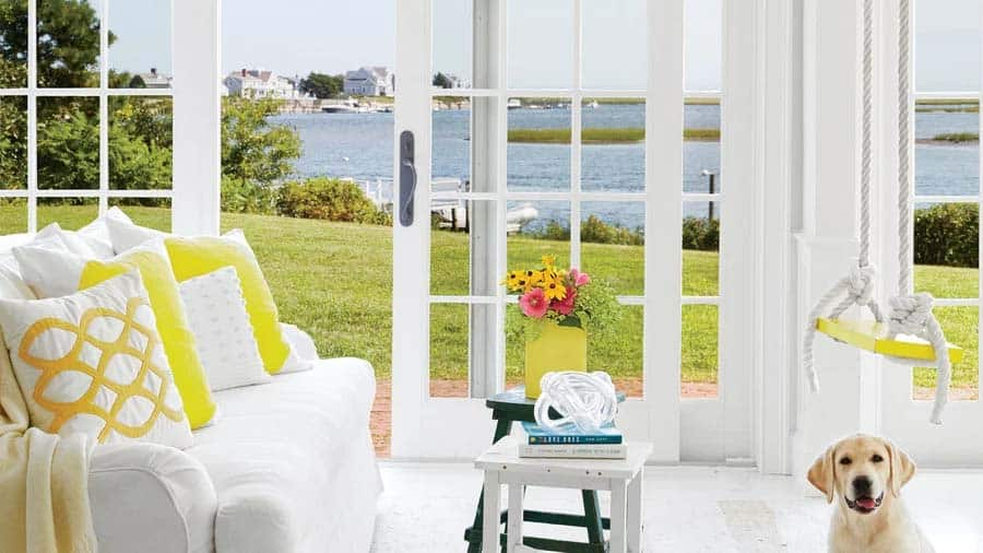 cape cod style cottage radiates with pops of sunshine yellow