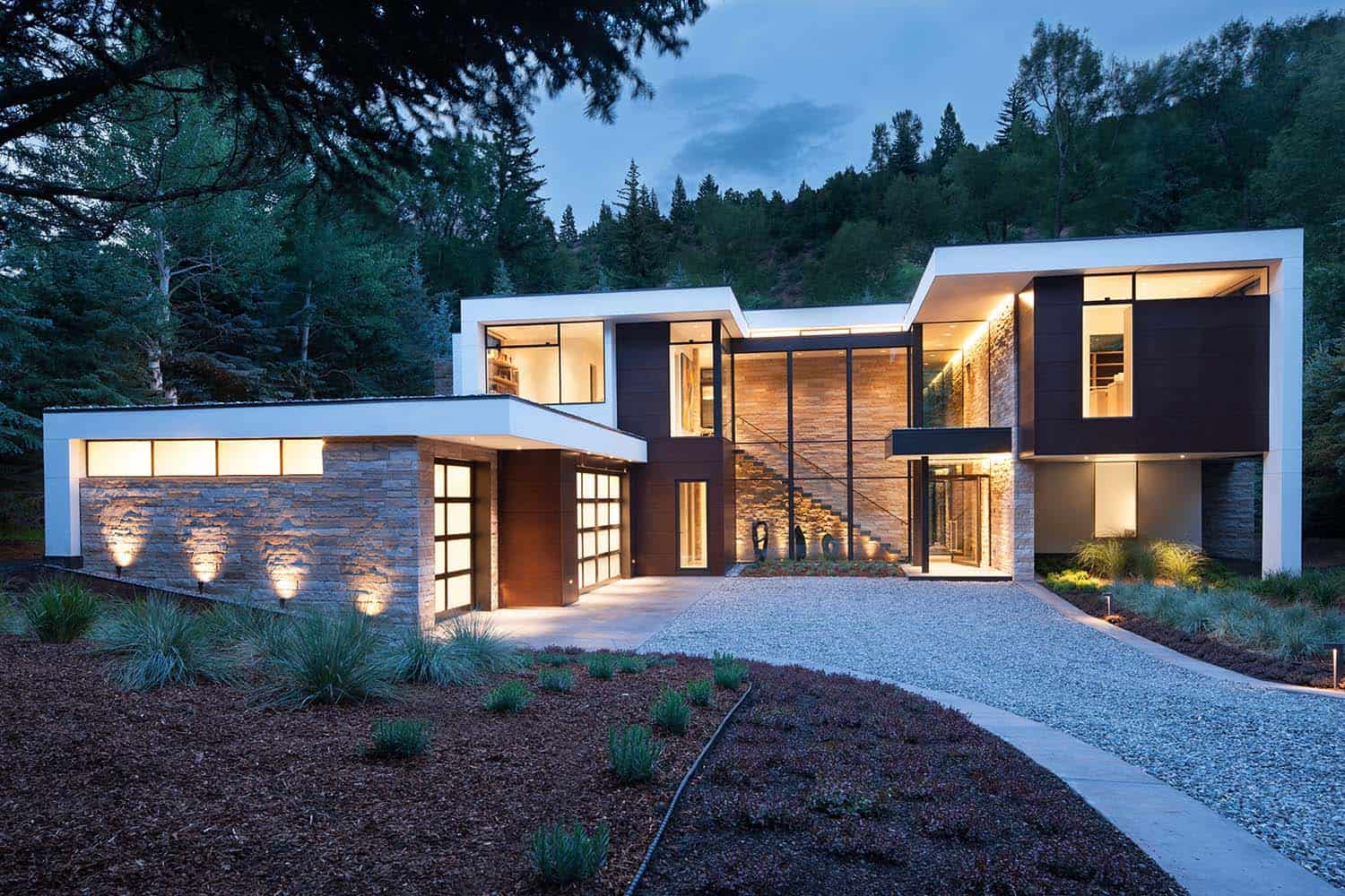 Dramatic stone and glass home in aspen surrounded by forest for Mtn house