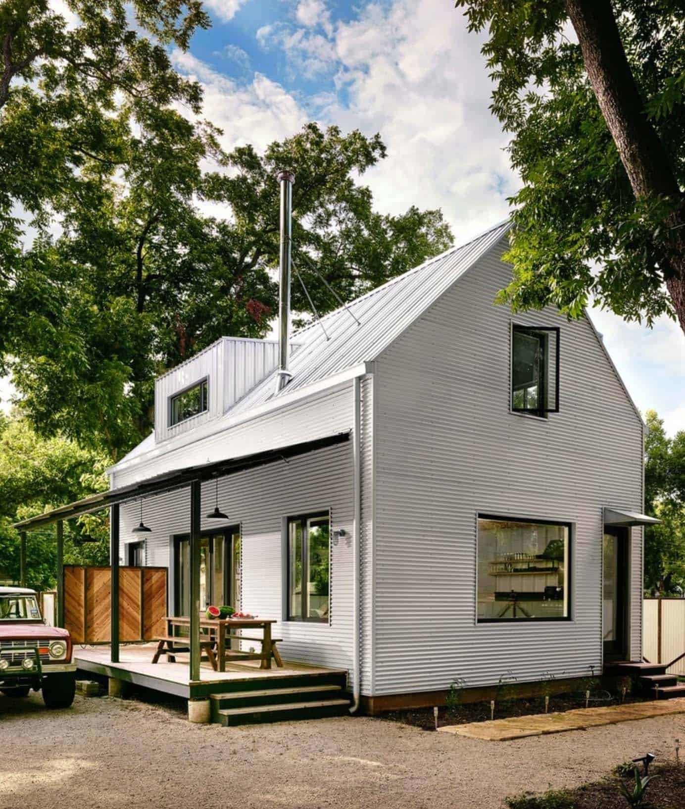 Small energy efficient farmhouse in austin designed for a for Farmhouse style siding