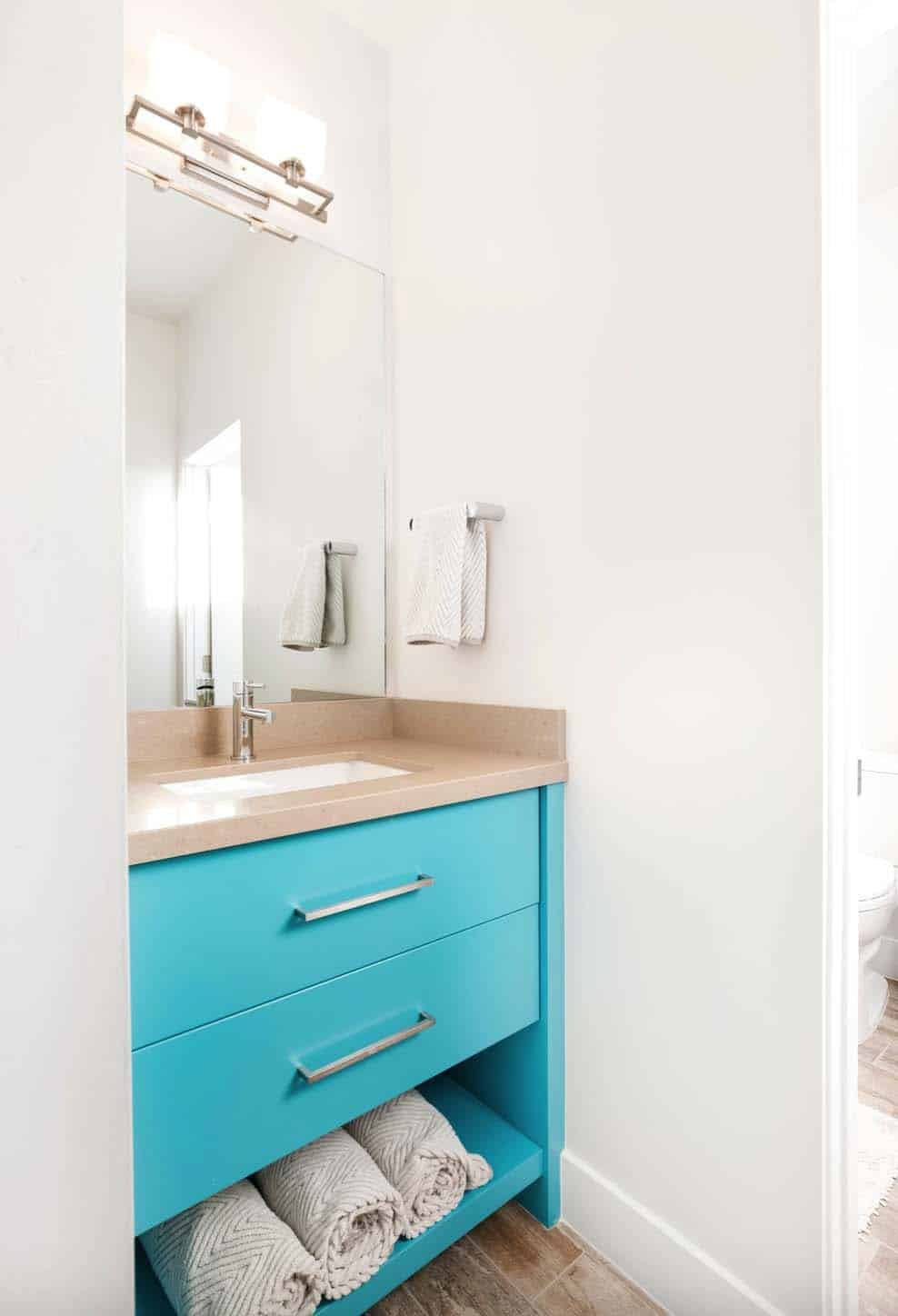 Above The Kids Bathroom Offers A Small Vanity With Cabinets Painted In Colorful Blue Tone