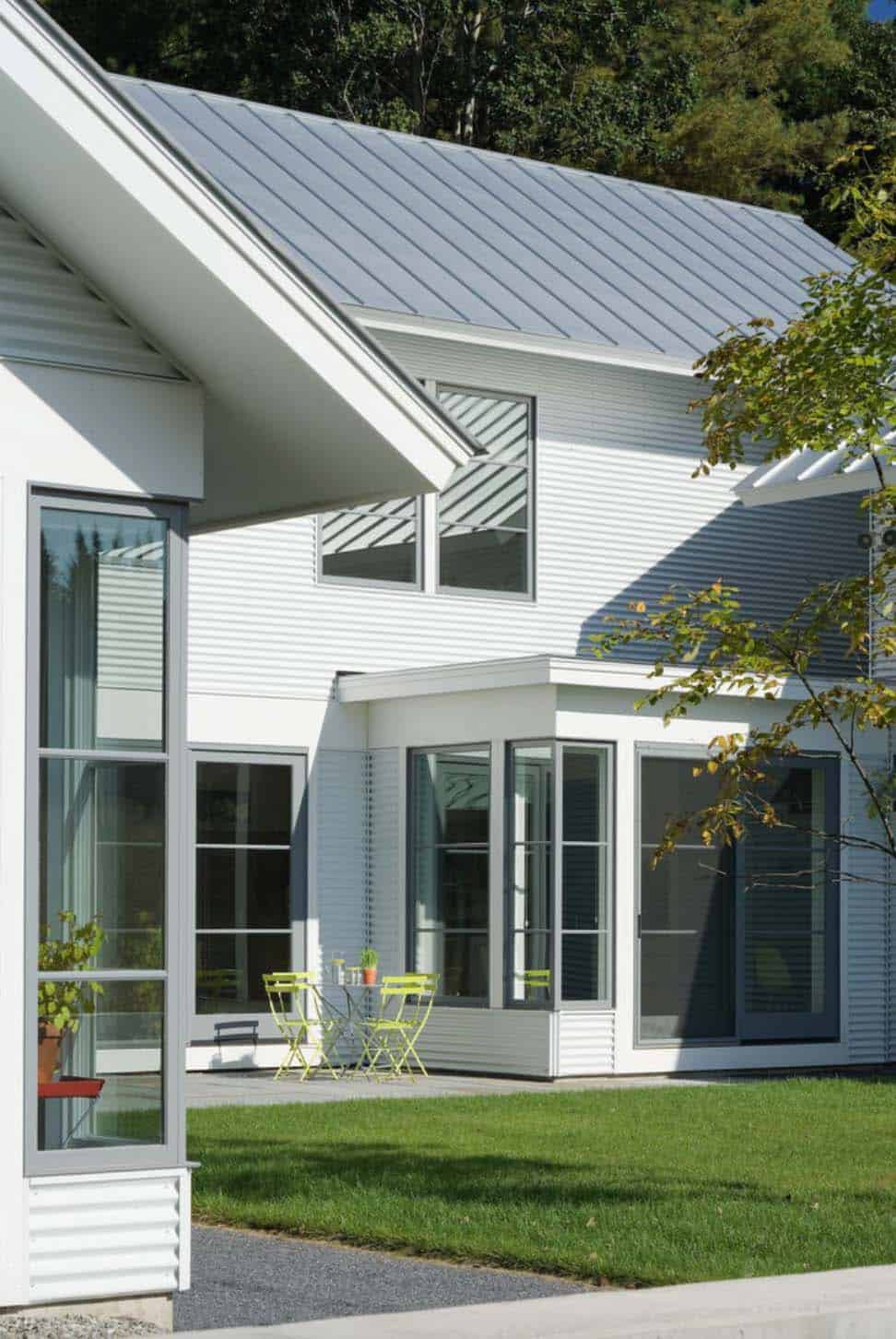 Beautifully designed modern farmhouse style in rural for Metal roof farmhouse