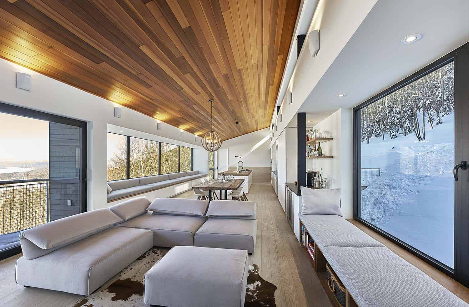 Modern ski chalet nestled in snowy slopes of the laurentian mountains