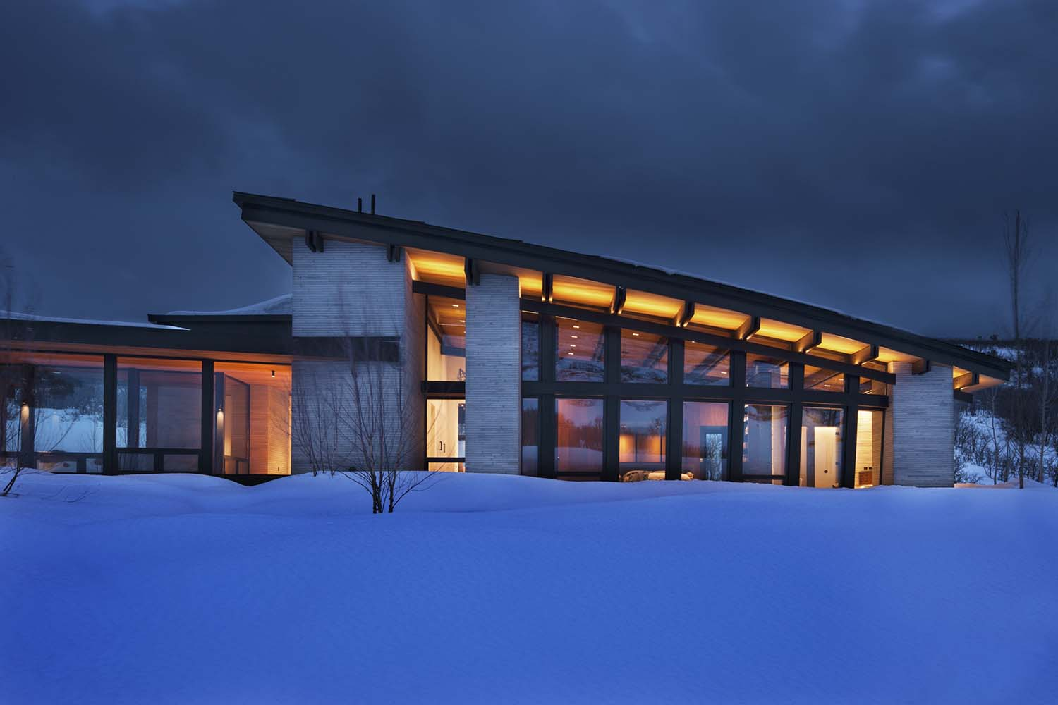 Majestic mountain home of stone and glass dominates its ...