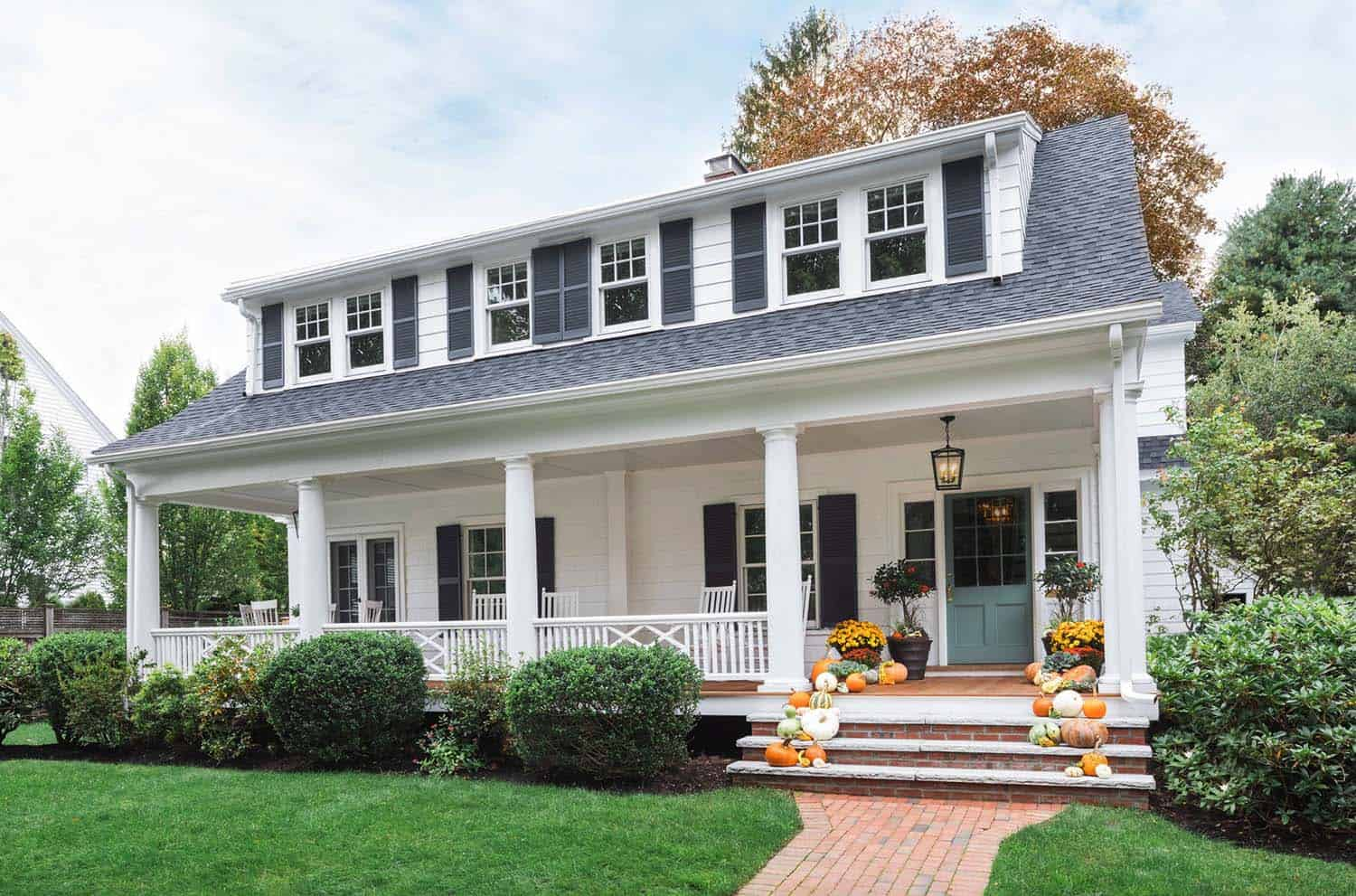 Beautifully renovated dutch colonial style home nestled in for New england colonial style