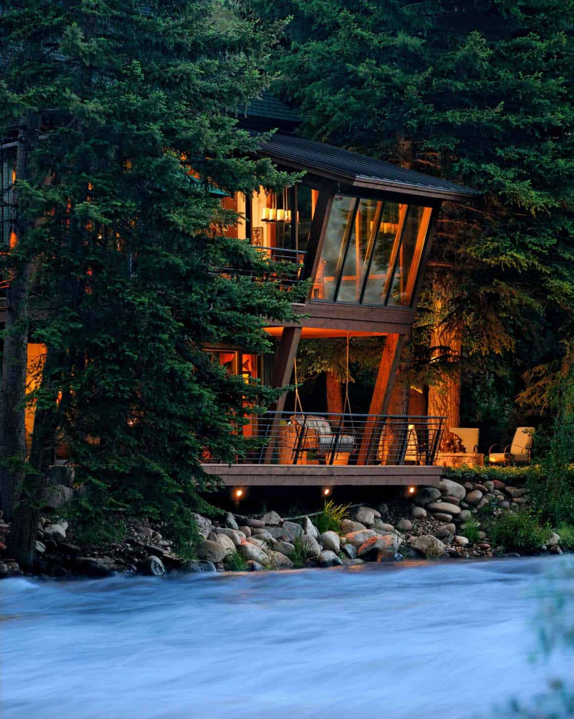 Modern treehouse suspended over a roaring river in old for Riverfront home plans