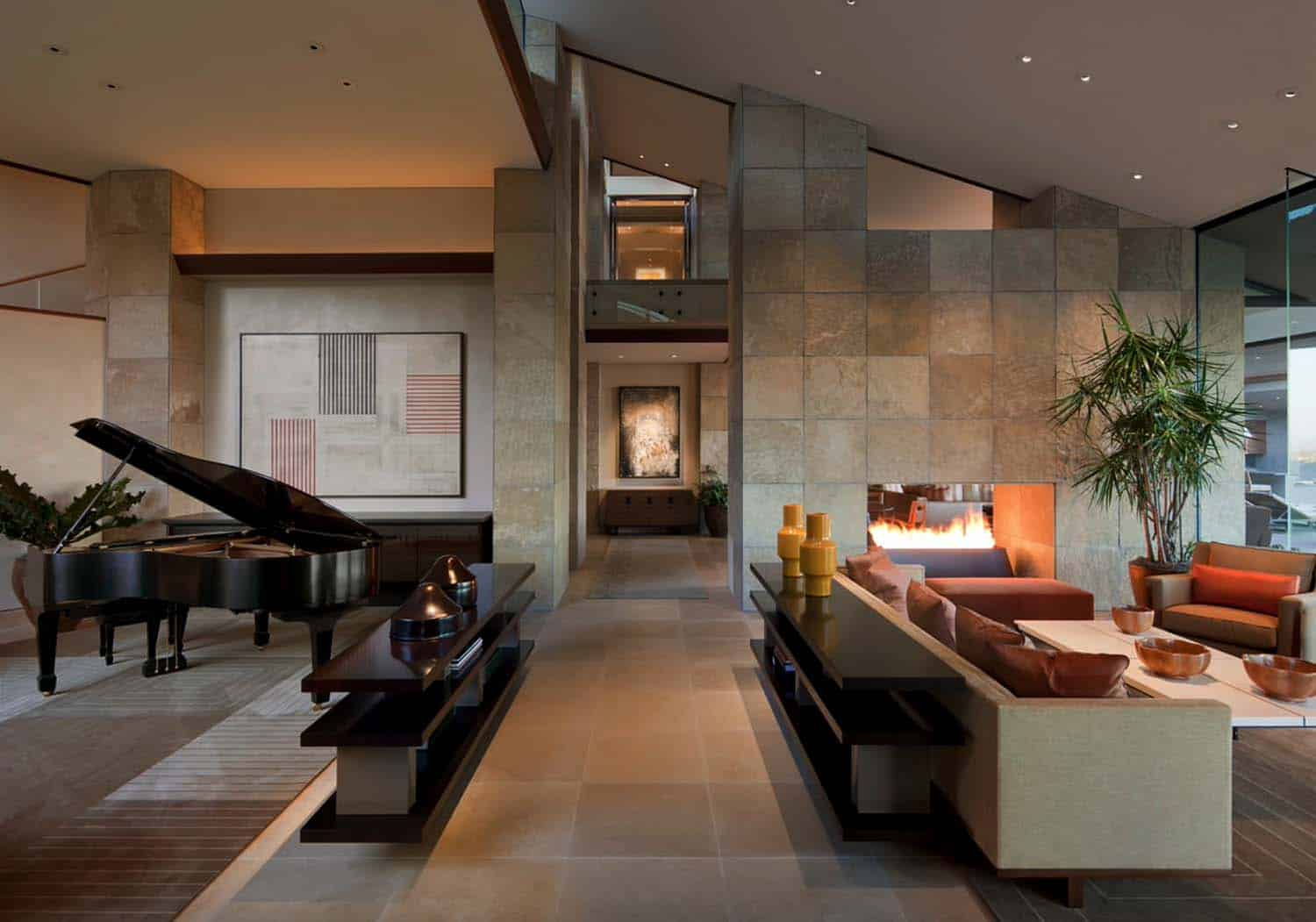 extraordinary living room piano idea | Modern desert home set on a rocky hillside with ...