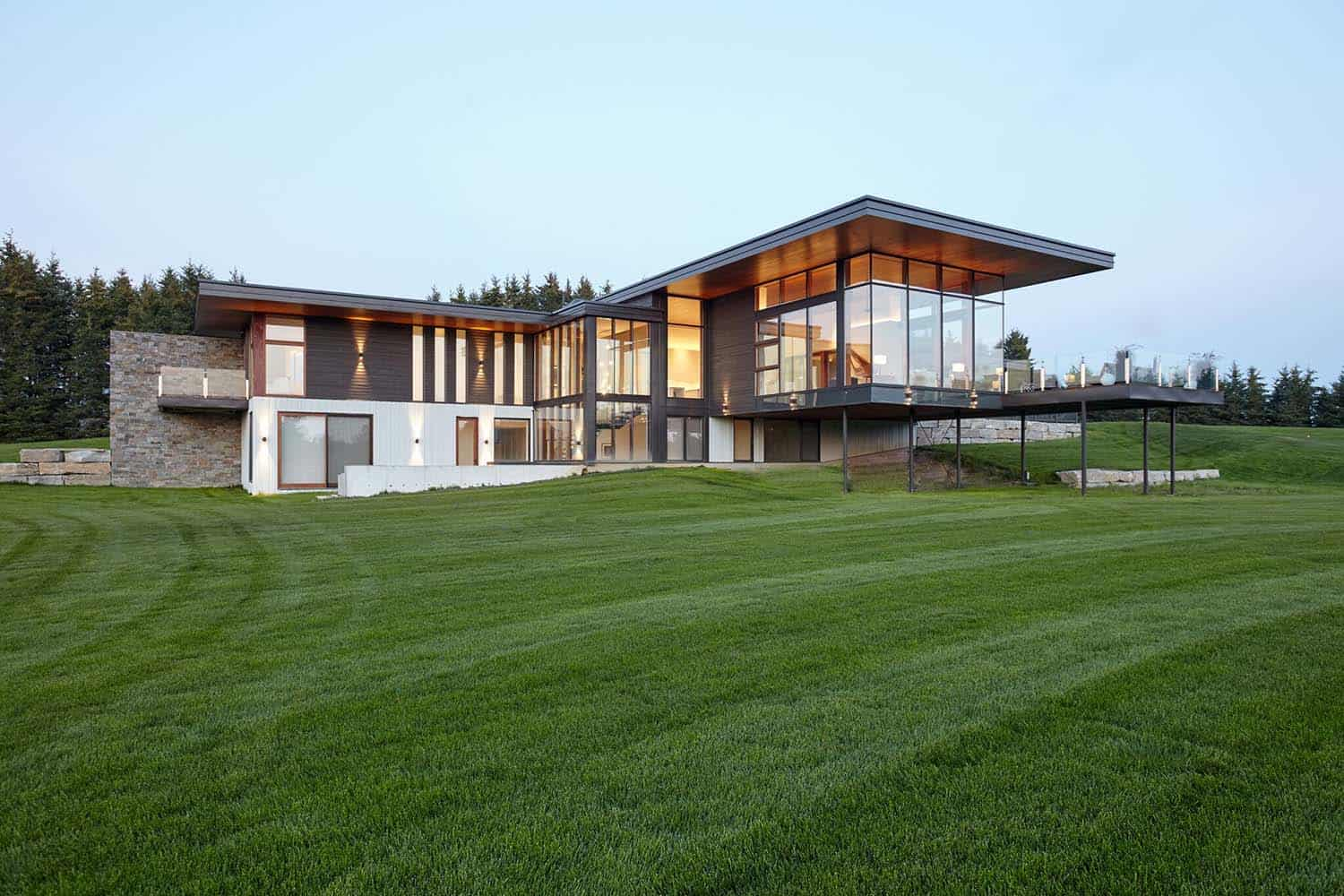 Modern country house cantilevers over a rolling landscape ...