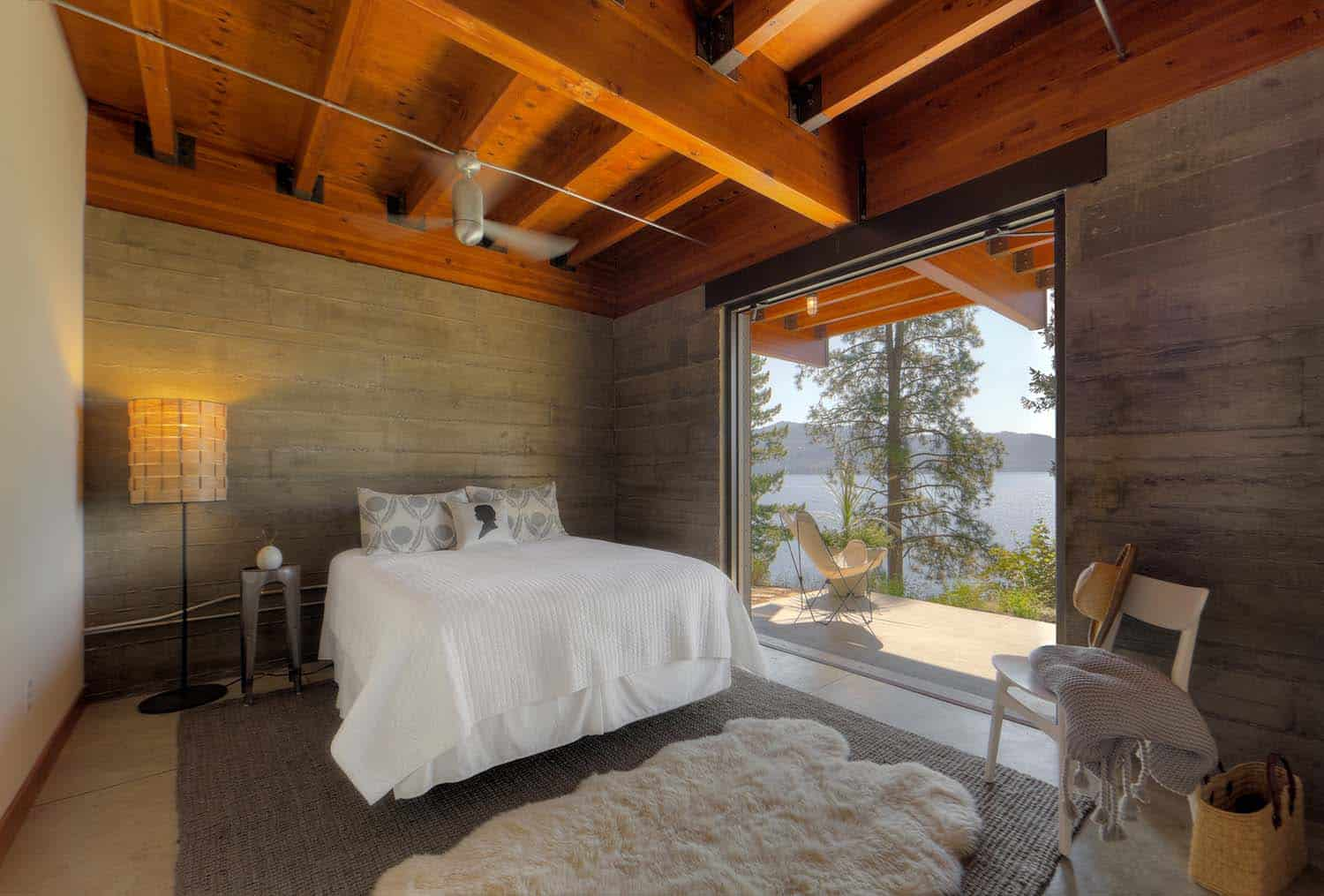 Modern log cabin perched on a cliff overlooking coeur d for One room log house