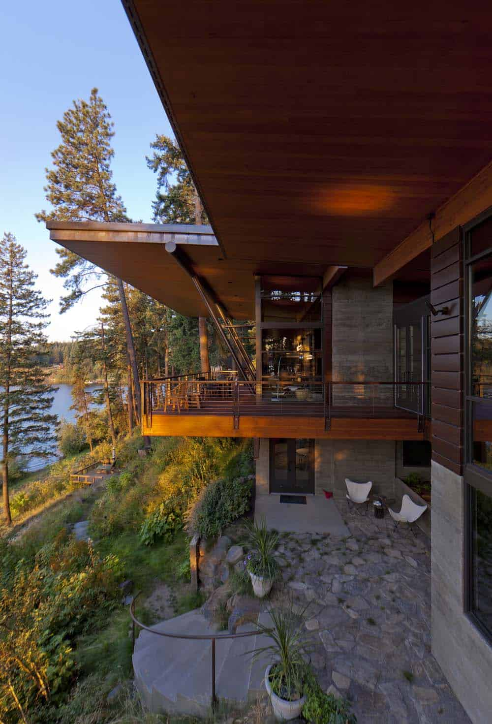 Modern Log Cabin ~ Modern log cabin perched on a cliff overlooking coeur d