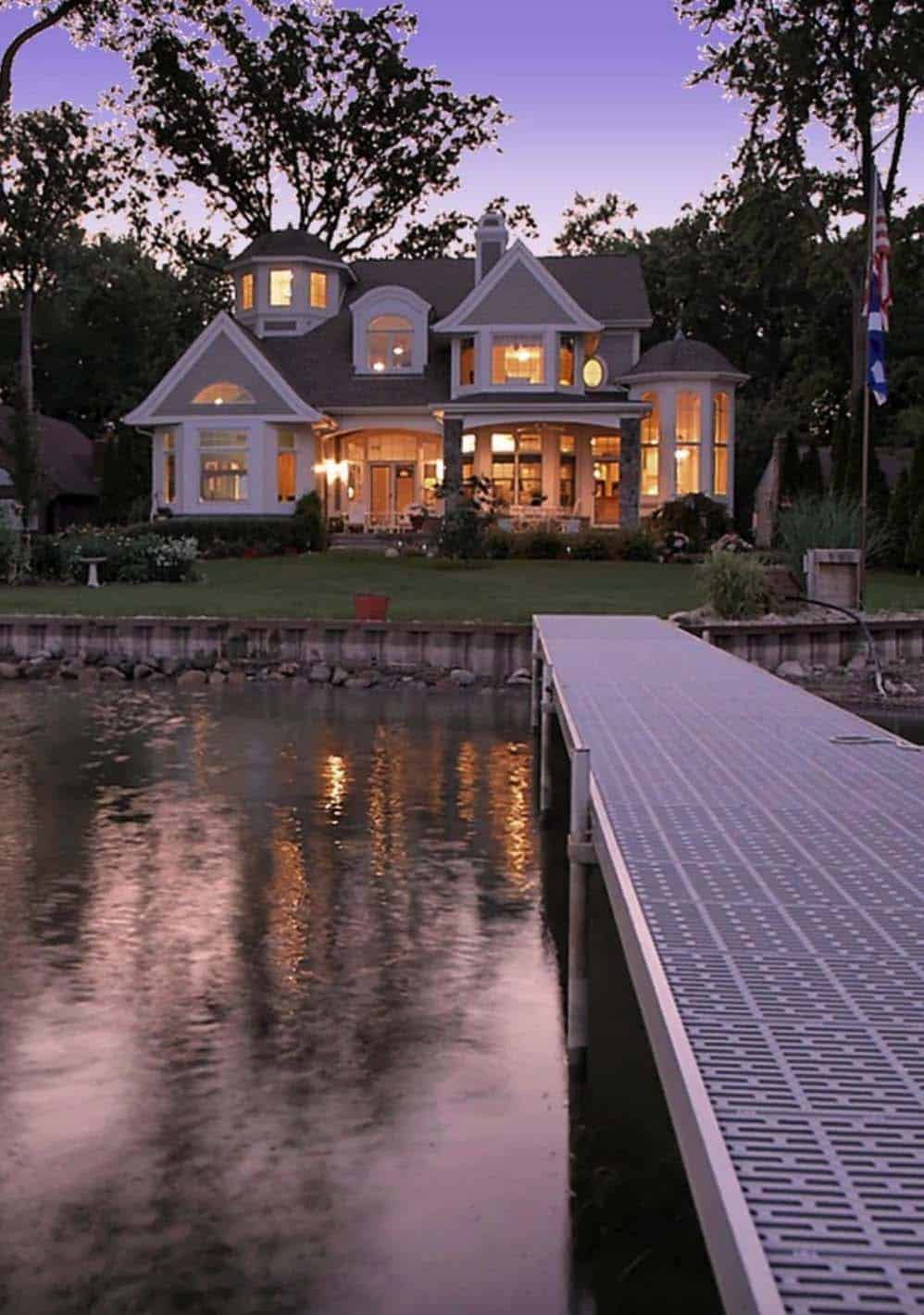 A cape cod inspired lake house designed for casual living in michigan for Lakefront home plans designs