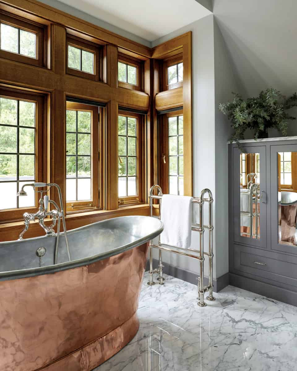 luxury-master-bathroom-with-copper-tub-and-marble-flooring
