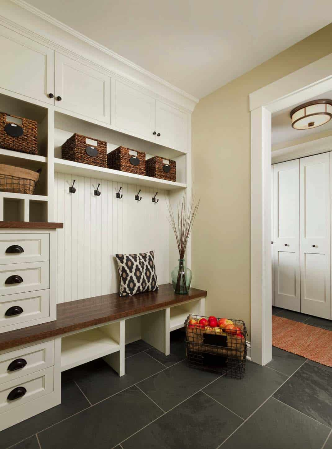 Mudroom Flooring Should Be Durable And Not Slippery Beadboard Paneling Painted In A Semigloss Finish Is The Wall Material Behind Built Bench