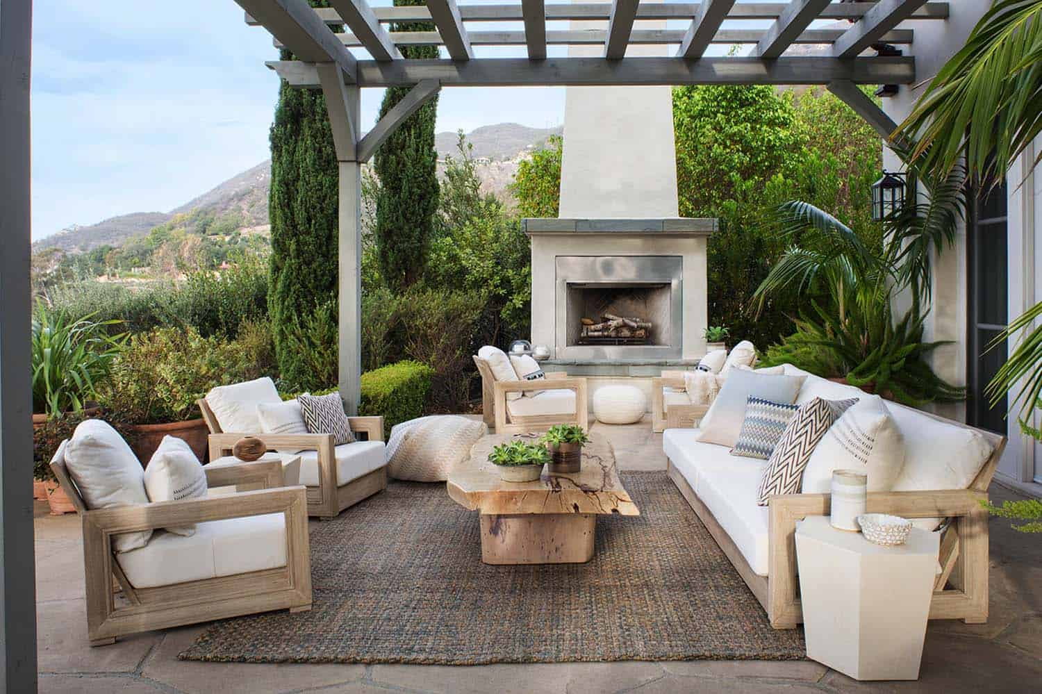 A Coastal Home In Santa Barbara California Offers Sweeping Views Over Canyon From Its Outdoor Terrace Furnishings Are Grouped Around An