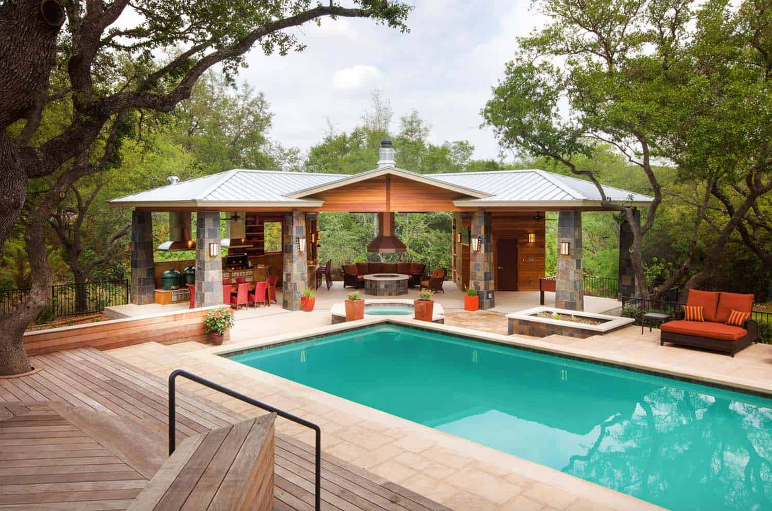 An Outdoor Living Paradise In Austin, Texas Features An Ipe Wood Deck That  Steps Down To The Pool, Which Is Surrounded By Concrete Tile.