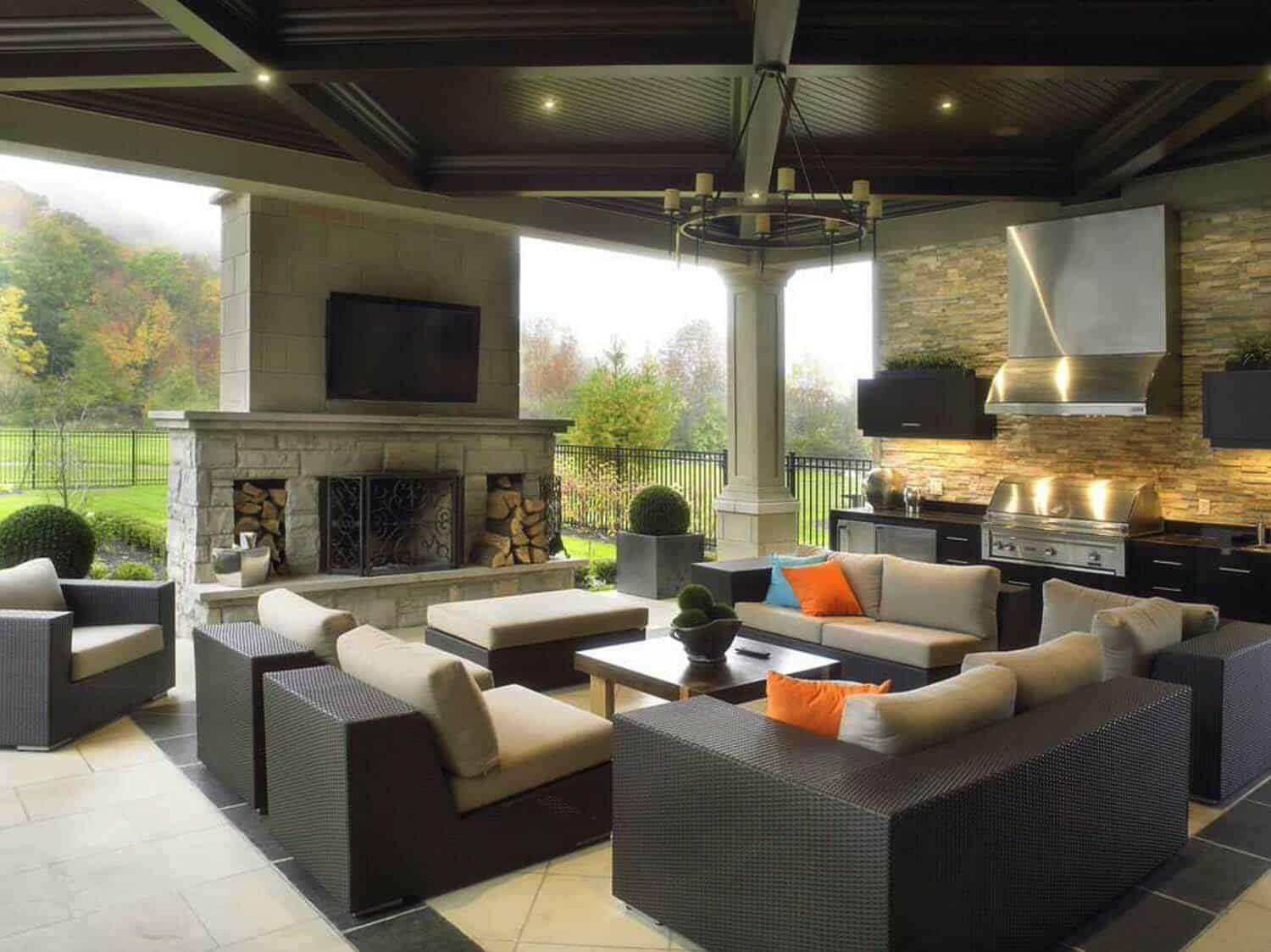 Comfortable Seating Is Set Around A Fireplace, While A Built In Kitchen  Wall Allows For Gourmet Outdoor Cooking.