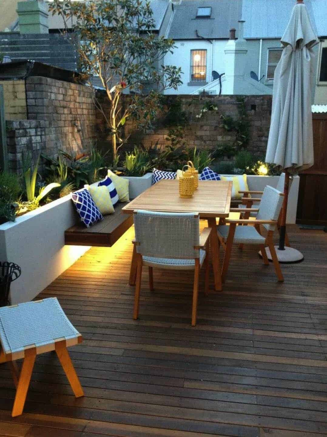 A Small Outdoor Entertaining Deck In Sydney Is Illuminated By Lights The Evening Back Wall An Existing Brick While Garden