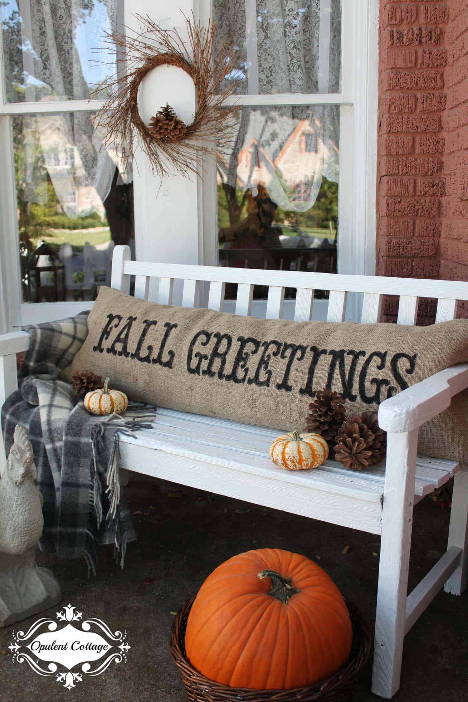 A Vintage Bench Is Adorned With A Fall Inspired Burlap Pillow
