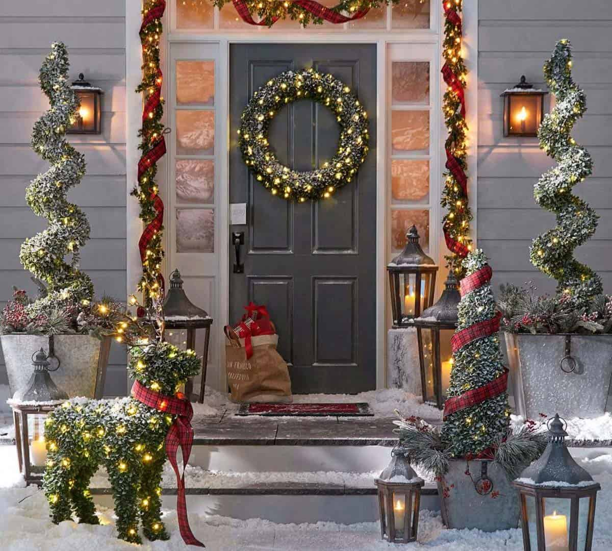 outdoor christmas decorated front door with boxwood garland