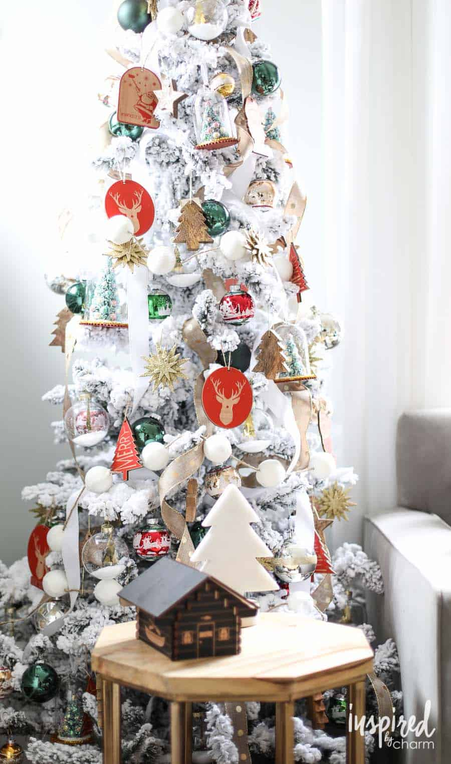 white-flocked-christmas-tree-red-green-gold-accents