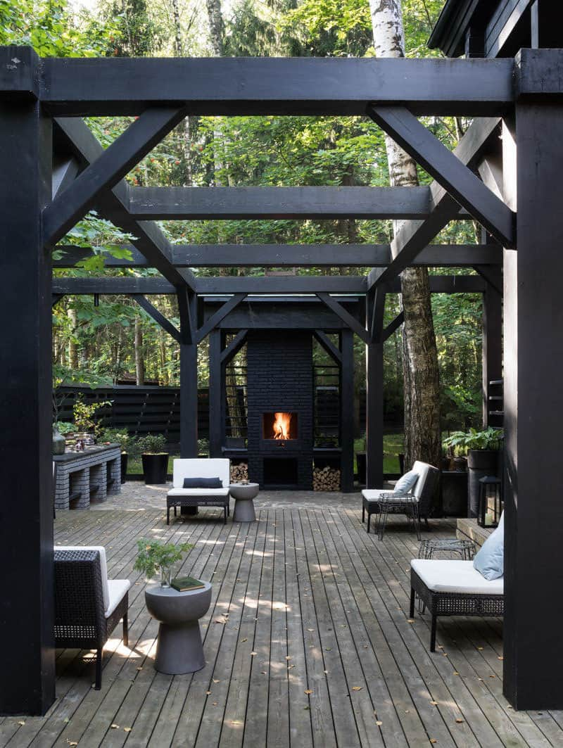 outdoor-deck-with-a-pergola-and-fireplace