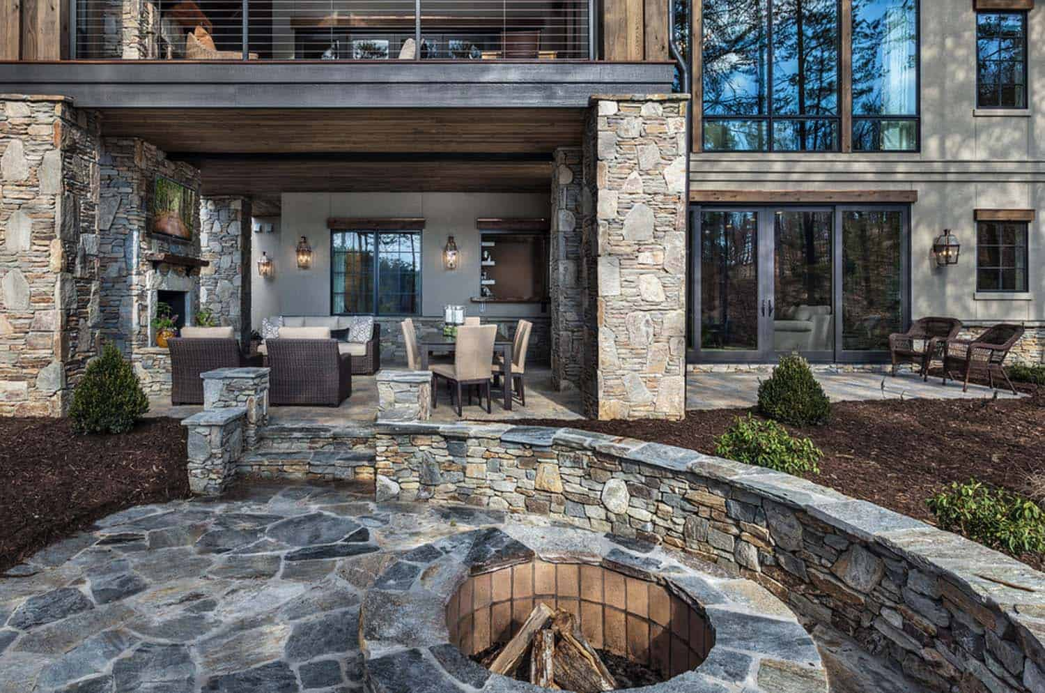 rustic-lakefront-retreat-exterior-deck-fire-pit