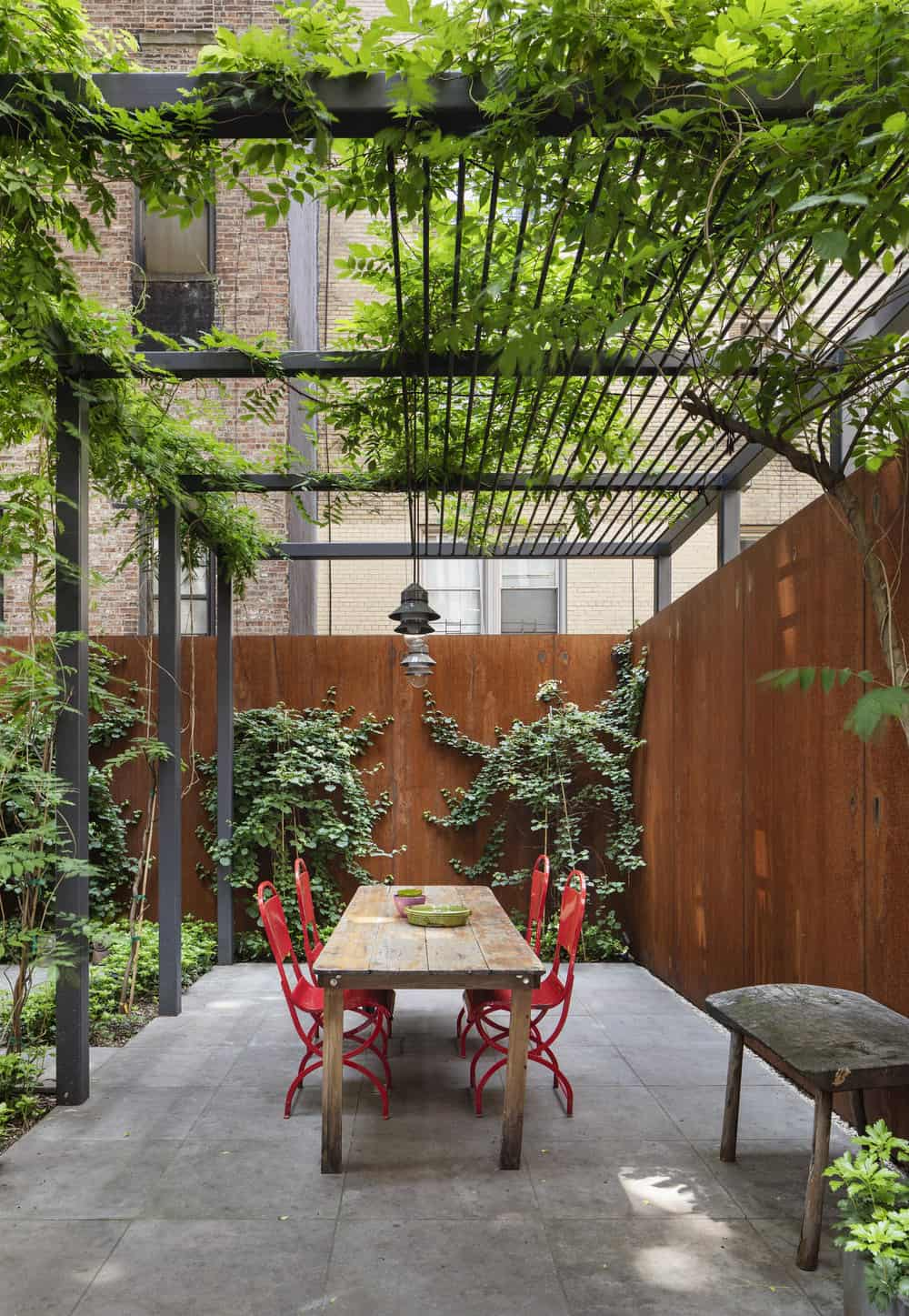 townhouse-patio-with-a-pergola
