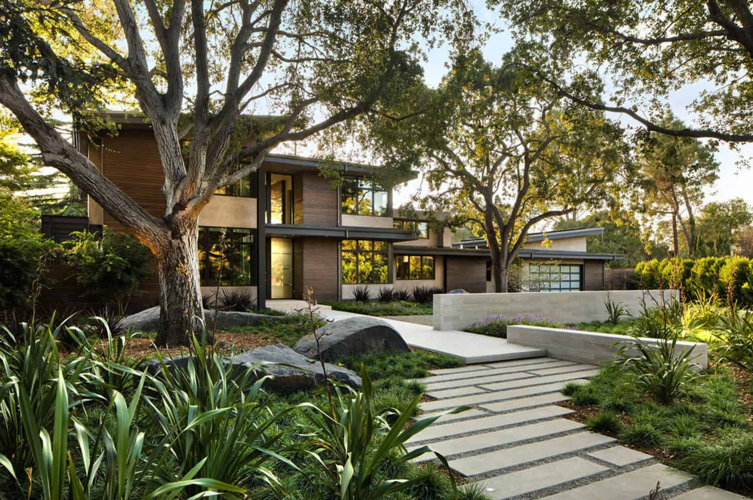 contemporary-home-exterior-with-lush-landscape