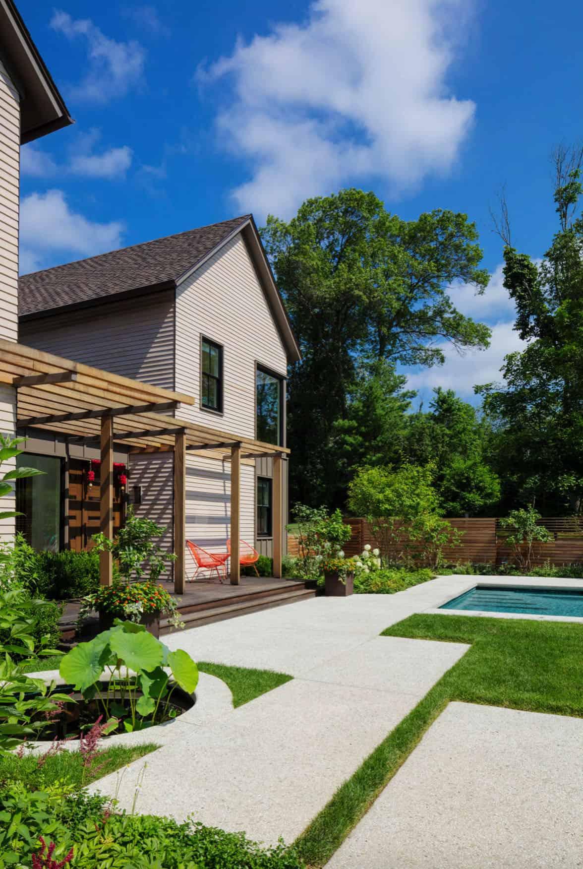 contemporary-home-exterior-koi-pond