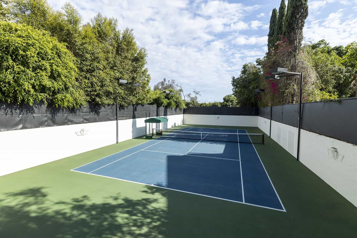 spanish-colonial-style-home-tennis-court