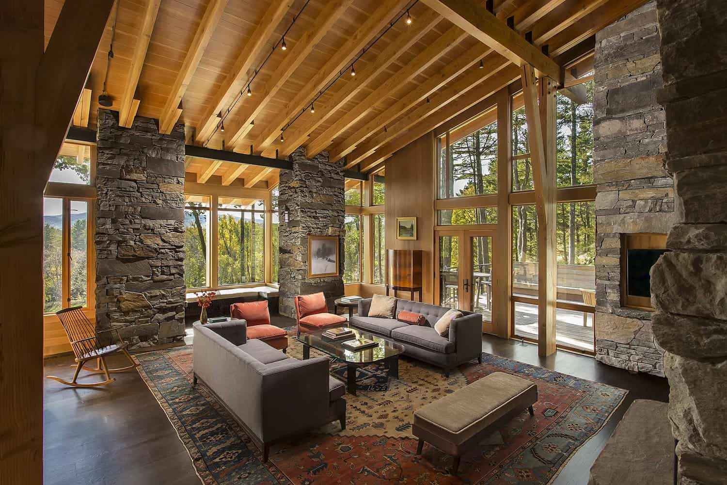Rustic-modern house organically forms into hillside in the Berkshires