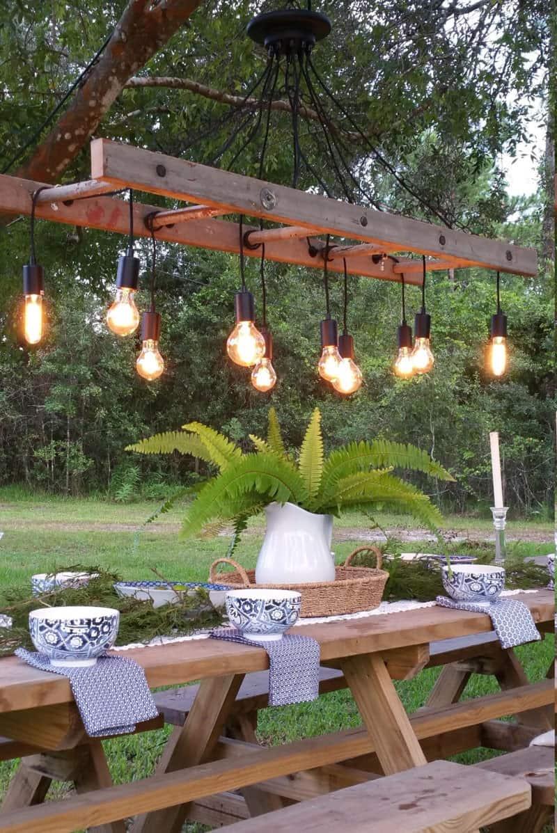 antique-farmhouse-ladder-chandelier-over-a-picnic-table