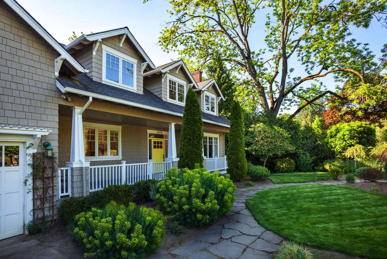 craftsman-cottage-remodel-exterior-with-yellow-front-door