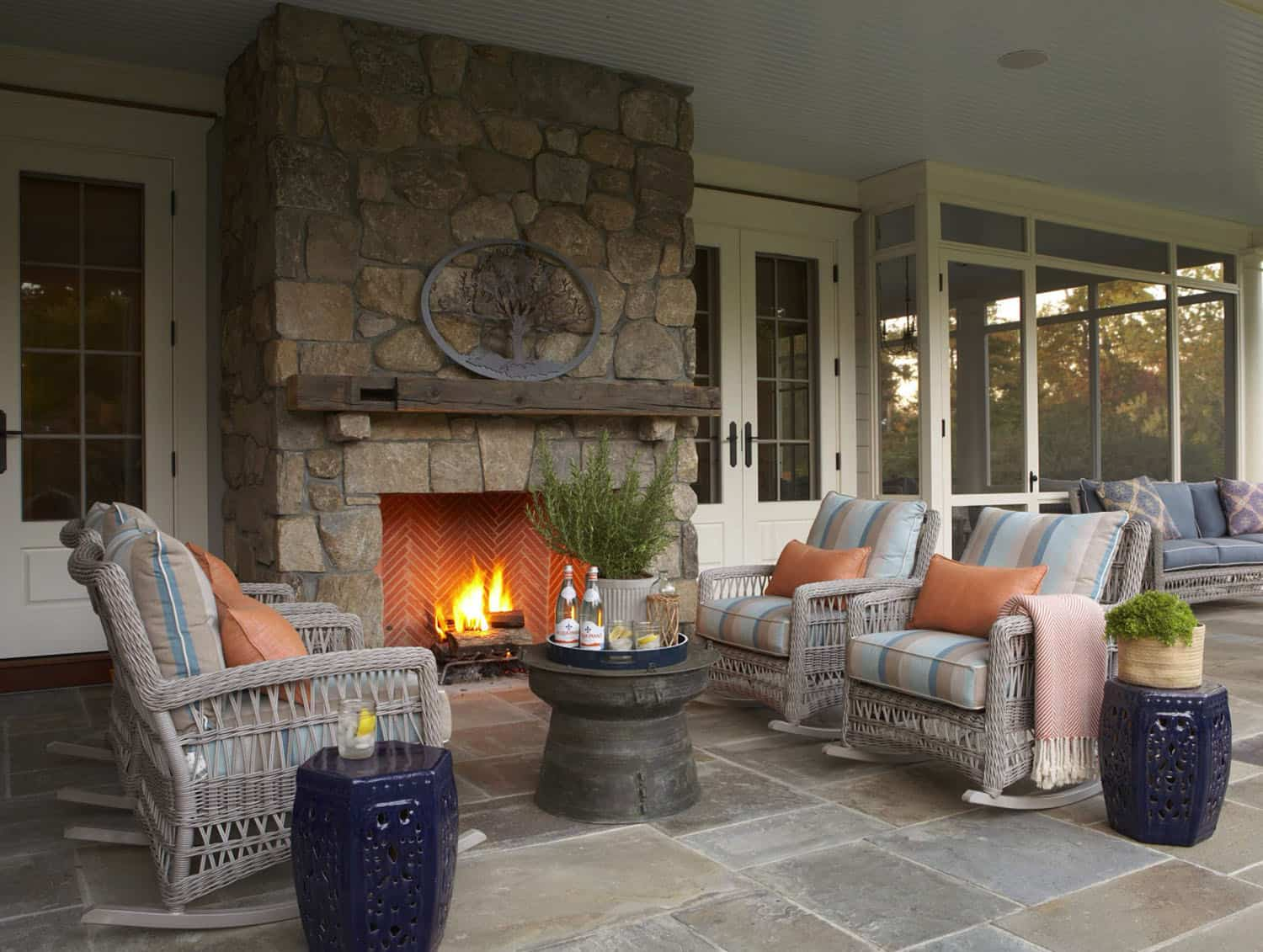 covered-porch-with-exterior-fireplace-traditional