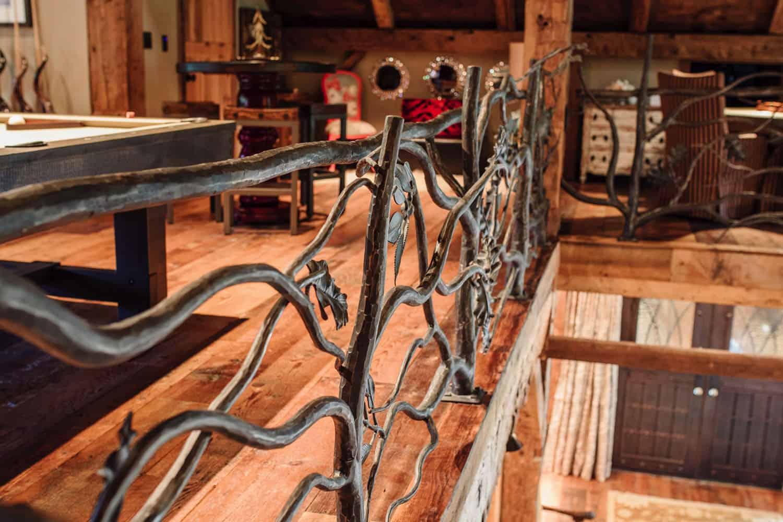 custom-bronze-handrail-rustic-family-room