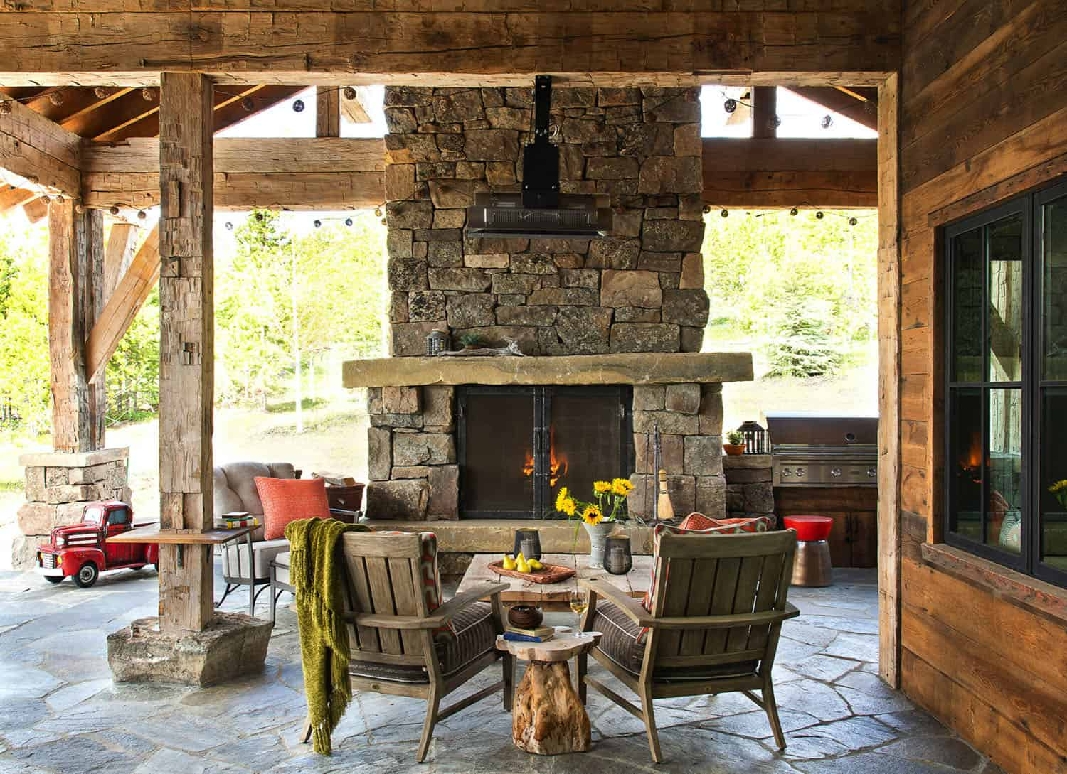 rustic-mountain-home-covered-patio-fireplace