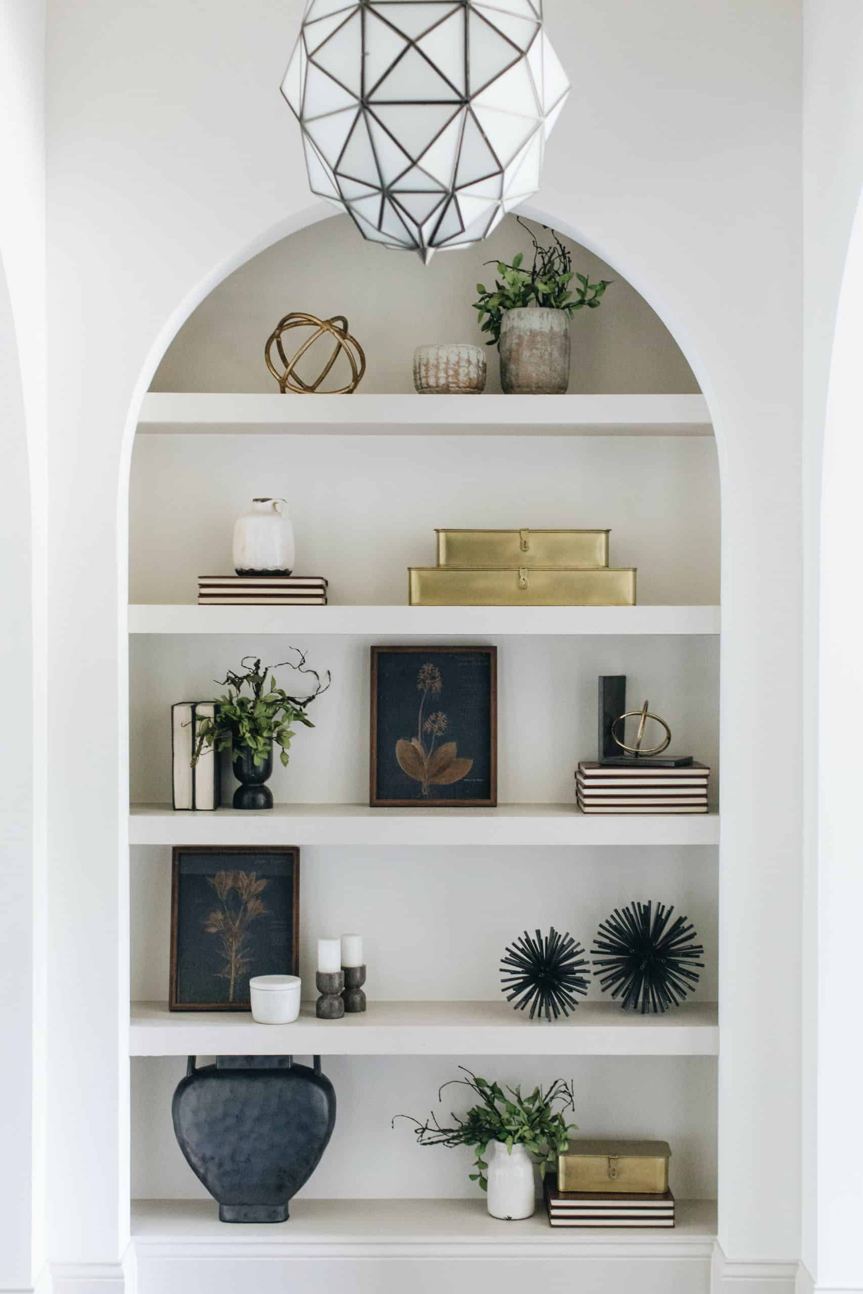 transitional-style-hallway-bookshelf-display